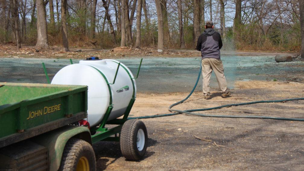 HS-150-P hydrseeder spraying at a golf course