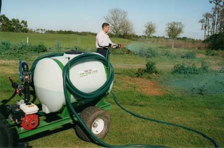 Turbo Turf's 100 gallon pull type hydroseeder working in Floridia