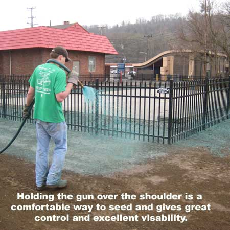 hydroseeding with the hose over the shoulder